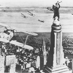 """FILE - In this 1933 file photo released by RKO Radio Pictures, King Kong stands atop New York's Empire State Building as he holds an airplane during an attack by fighter planes in a scene from """"King Kong."""""""