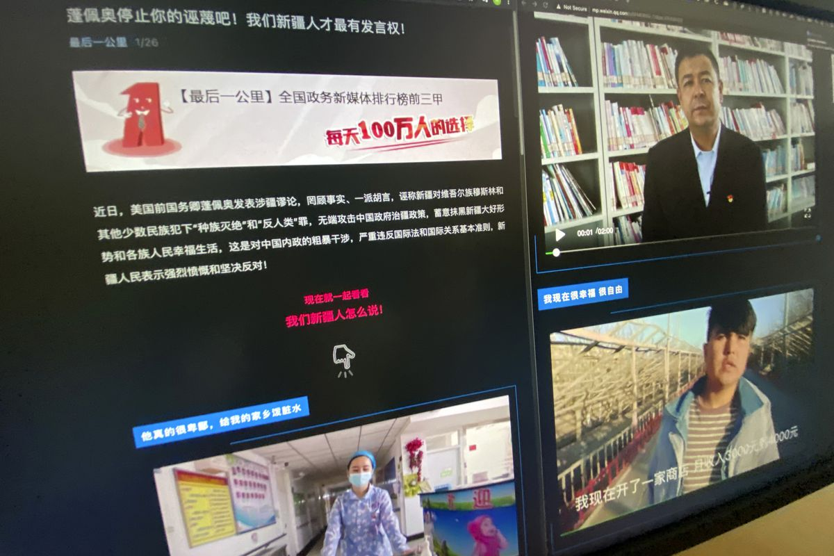 """A webpage with the title """"Pompeo stop your slanders! Only We Xinjiang people have a say!"""" and videos of ethnic Uyghurs responding to former U.S. Secretary of State Mike Pompeo is seen on a computer screen in Beijing on Wednesday, May 19, 2021."""