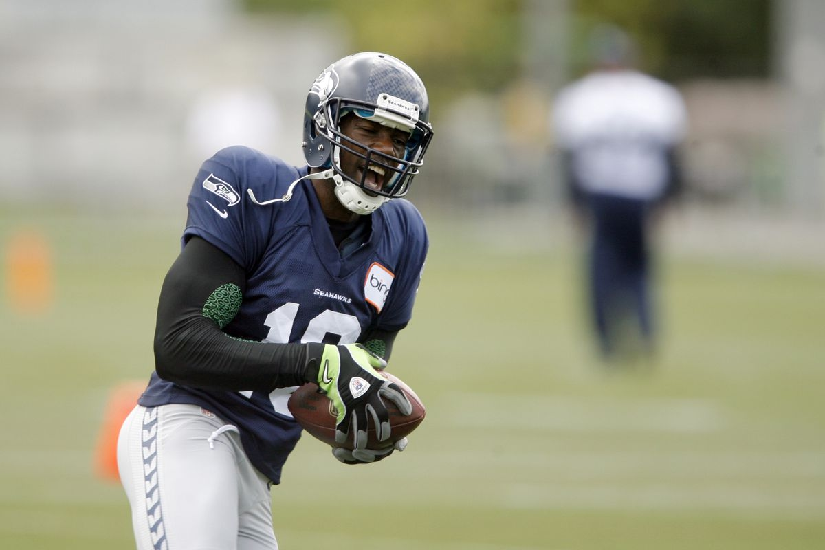 Aug 8, 2012; Renton, WA, USA; NFL: Seattle Seahawks wide receiver Terrell Owens (10) catches a pass during training camp practice at the Virginia Mason Athletic Center. Mandatory Credit: Joe Nicholson-US PRESSWIRE