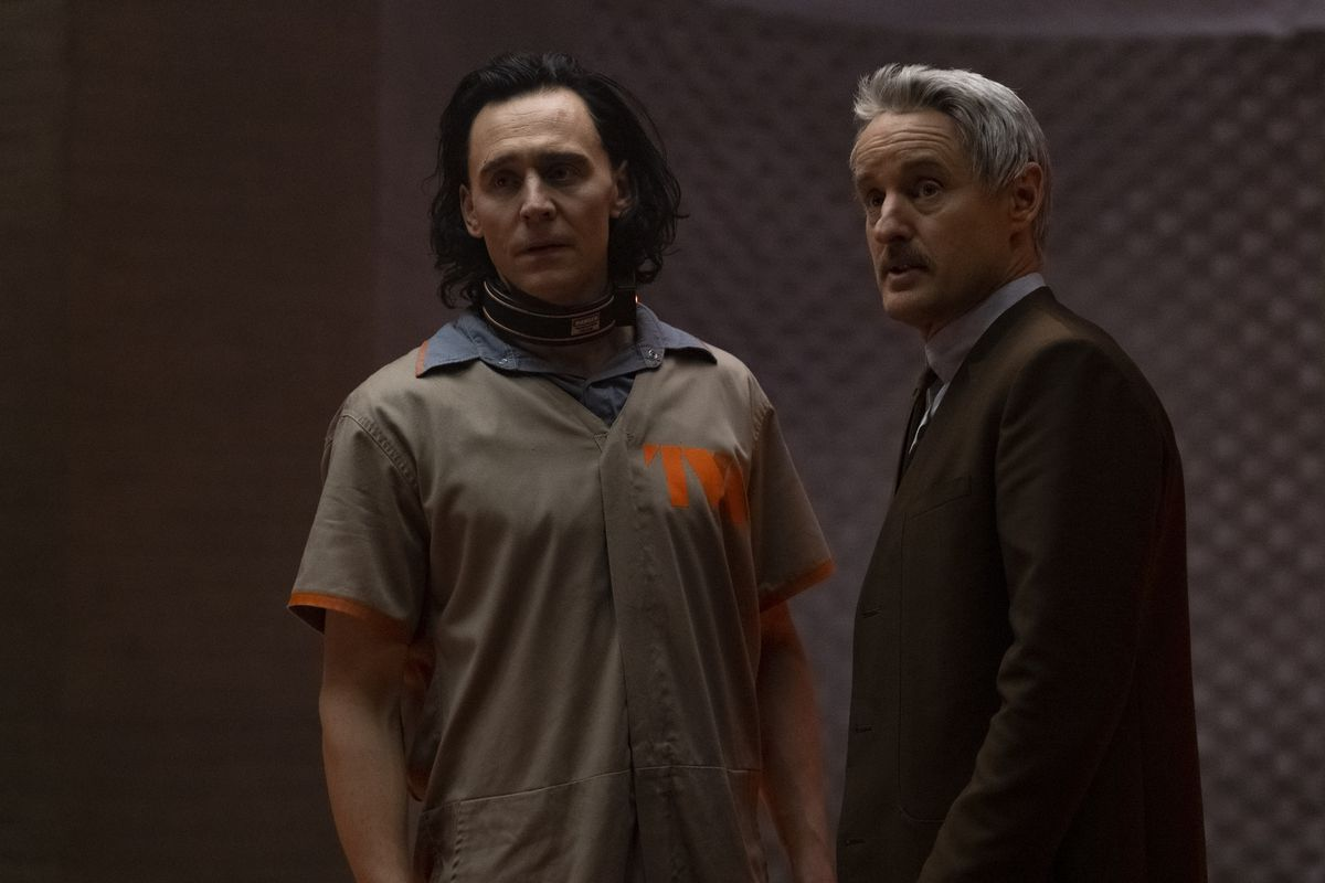 Owen Wilson and Tom Hiddleston stand facing the camera in the Disney Plus series Loki