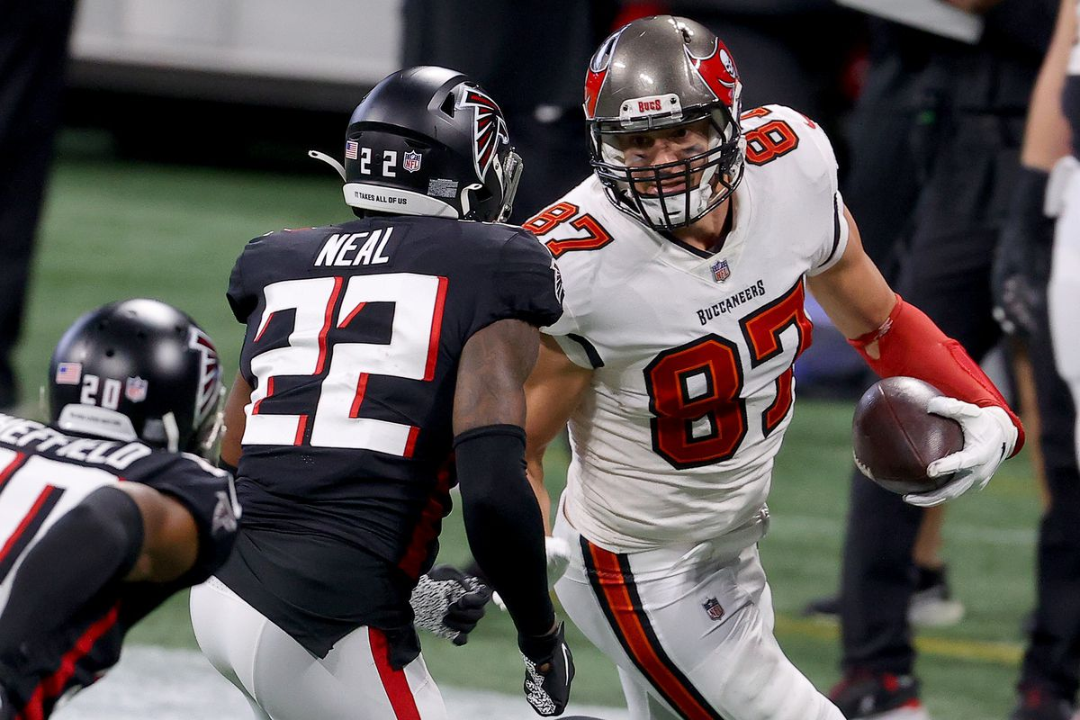 Rob Gronkowski #87 of the Tampa Bay Buccaneers catches a pass against Keanu Neal #22 of the Atlanta Falcons during the second quarter in the game at Mercedes-Benz Stadium on December 20, 2020 in Atlanta, Georgia.