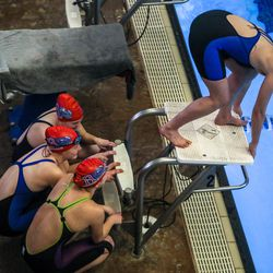 Swimmers get ready to race at the 3A women's swimming state meet at the South Davis Recreation Center in Bountiful on Saturday, Feb. 13, 2021.