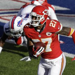 Kansas City Chiefs cornerback Sean Smith (27) intercepts a pass intended for Buffalo Bills wide receiver T.J. Graham (11) who is tackled by Kansas City Chiefs cornerback Marcus Cooper (31) in the end zone and returns it for a touchdown during the third quarter of an NFL football game in Orchard Park, N.Y., Sunday, Nov. 3, 2013.