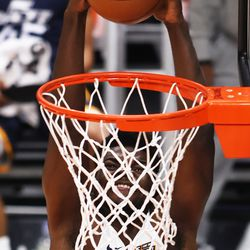 Utah Jazz White team center Udoka Azubuike (20) goes up for a dunk as the Utah Jazz Blue and White teams play in summer league action at Vivint Smart Home Arena in Salt Lake City on Friday, Aug. 6, 2021.