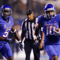 Jeremy Ioane of the Boise State Broncos, right, runs after making an interception against BYU during NCAA football in Boise, Thursday, Sept. 20, 2012. At left is Jamar Taylor of the Boise State Broncos.