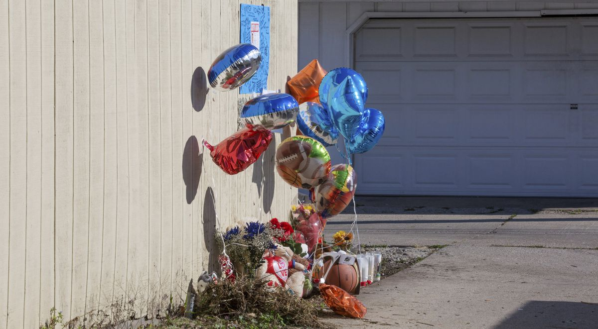 A makeshift memorial is shown in November 2015 at the spot in an alley where Tyshawn Lee was fatally shot.