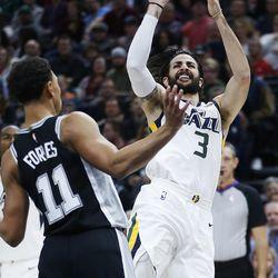 Utah Jazz guard Ricky Rubio (3) shoots over San Antonio Spurs guard Bryn Forbes (11) in Salt Lake City on Thursday, Dec. 21, 2017.
