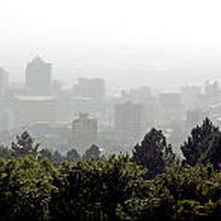 Smoke from the Milford Flat Fire, as well as other blazes in Salt Lake and Utah counties, blankets Salt Lake City on Saturday.