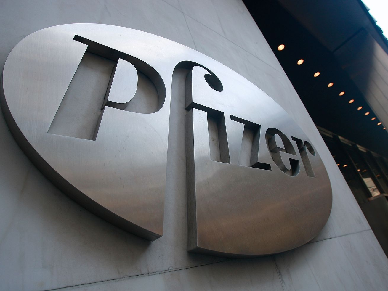 A Pfizer sign hangs outside of the drug company's headquarters in New York City.