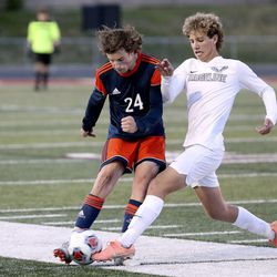 Mountain Crest's Conner Leishman and Ridgeline's Jackson Hulse fight for the ball during the 4A boys soccer semifinals at Jordan High School in Sandy on Monday, May 17, 2021. Ridgeline won 1-0.
