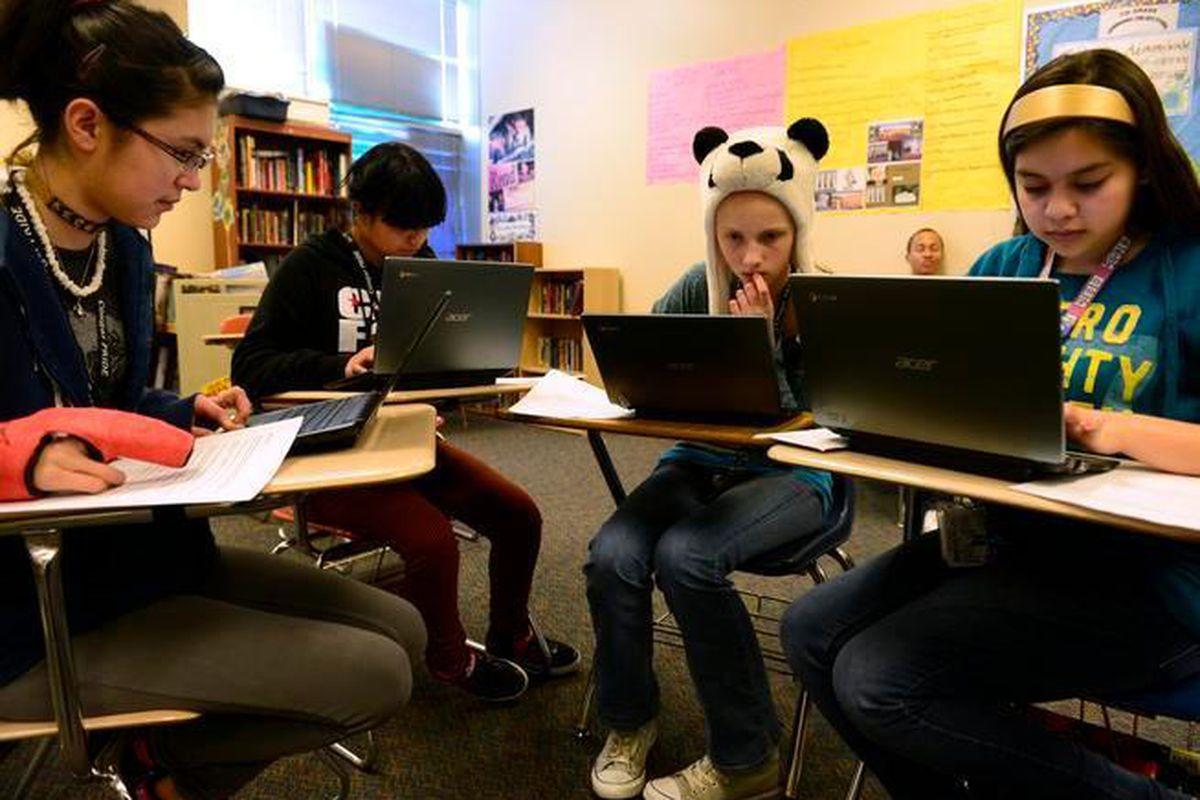 Dulcinea Sorrell, 14, Kenia Castro, 14, Rachel Ross, 13, and Victoria Pasillas, 13,  use Chromebooks to prepare for state tests in a language arts class at Aurora's Columbia Middle School.