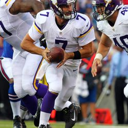 Aug 16, 2013; Orchard Park, NY, USA;  Minnesota Vikings quarterback Christian Ponder (7) looks to hand the ball off during the first half against the Buffalo Bills at Ralph Wilson Stadium.