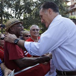 Republican presidential candidate, former Massachusetts Gov. Mitt Romney greets Thomas and Patricia Evans, of St. Mary's, Ga., during a campaign event at Flagler college, Monday, Aug. 13, 2012, in St. Augustine, Fla.