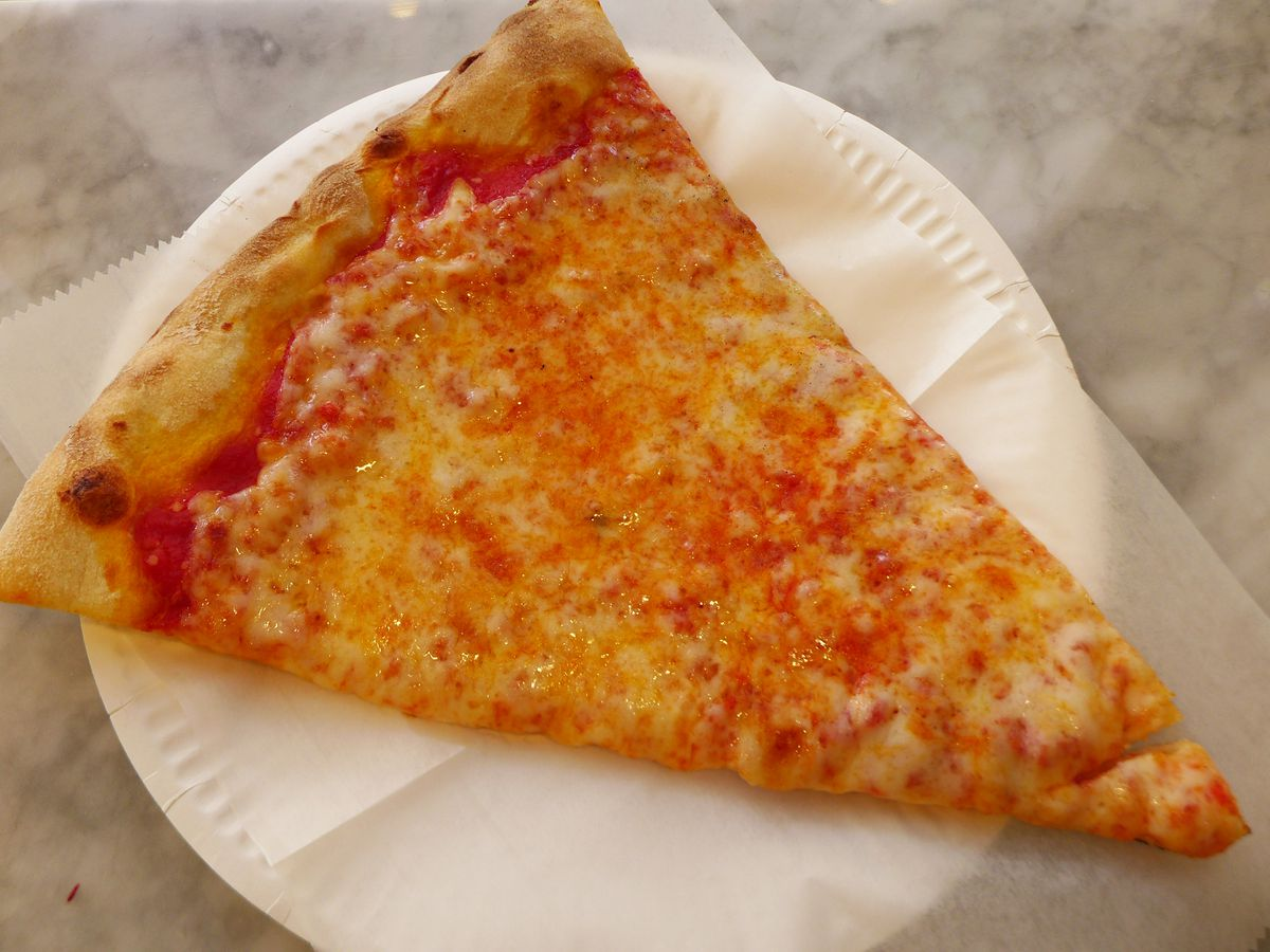 A slice of plain cheese pizza with tip pointing down and to the right.