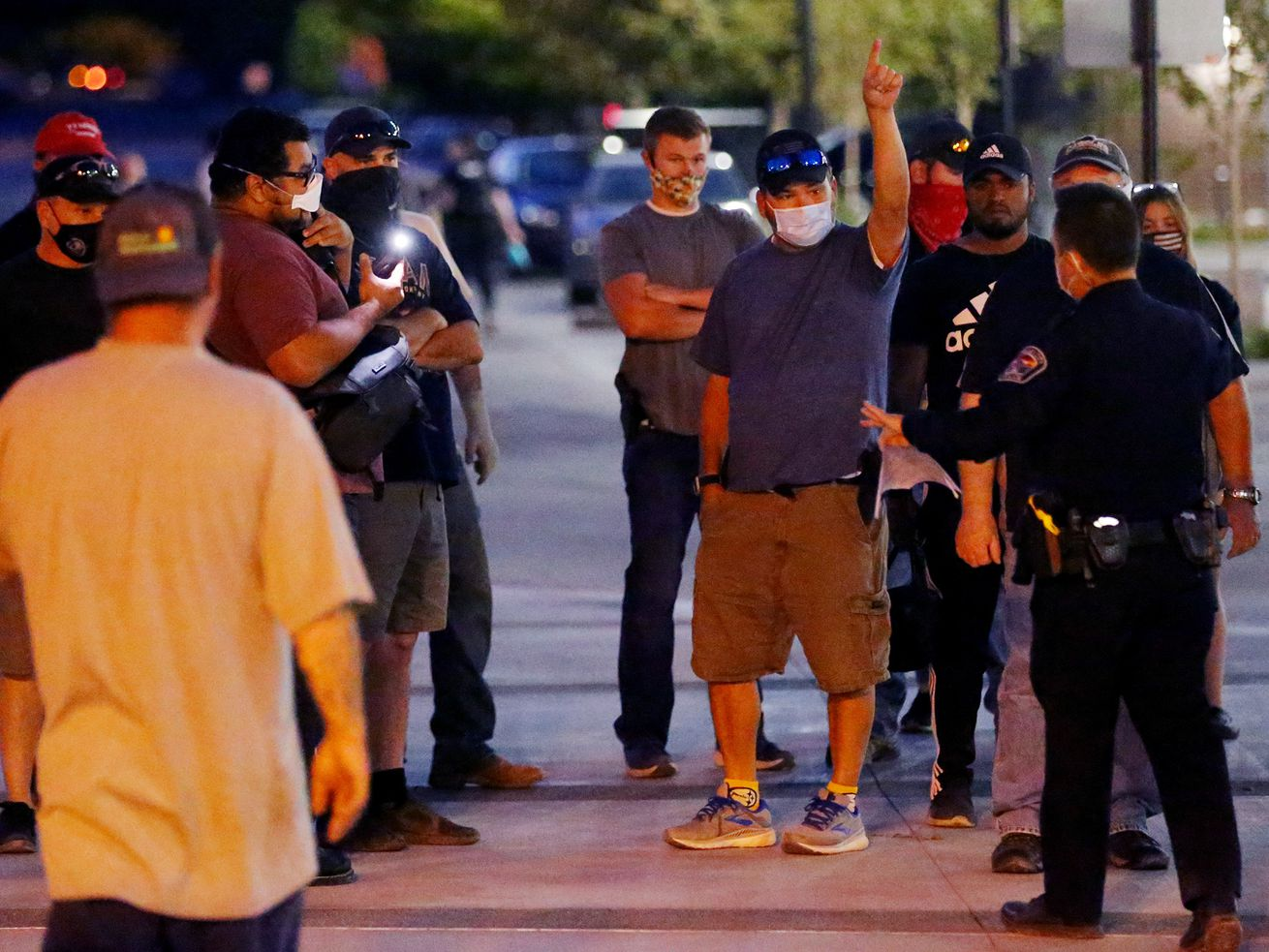 Counterprotesters try to get police to remove a man taking video of them during a demonstration at the West Valley City Police Department on Wednesday, Sept. 16, 2020.