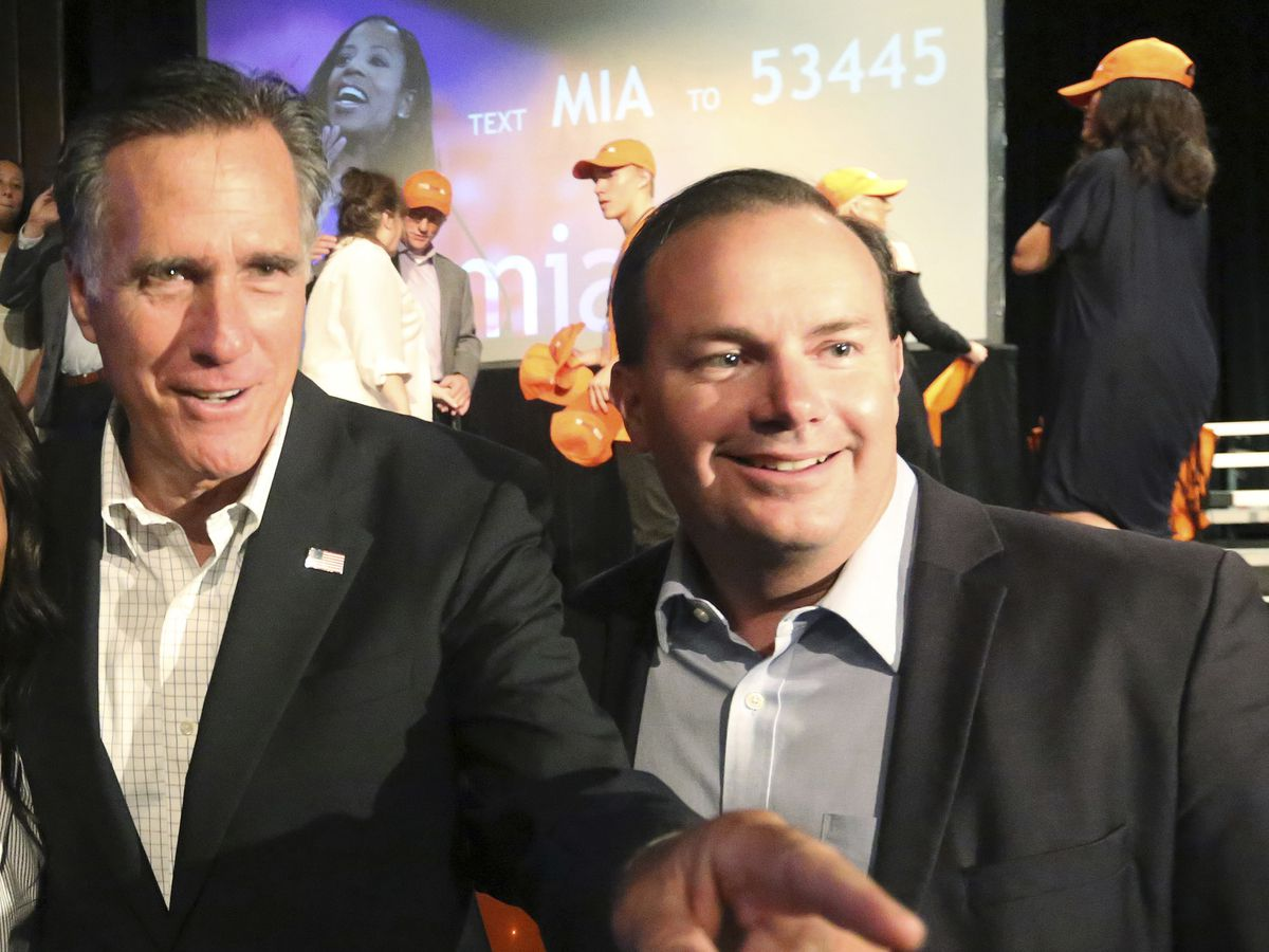 Sen. Mitt Romney, R-Utah and Sen. Mike Lee, R-Utah, right, during a campaign rally for former Congresswoman Mia Love, Friday, Aug. 24, 2018, in Lehi, Utah.