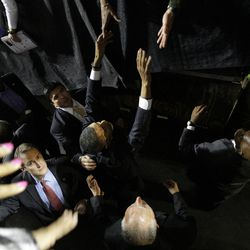 FILE - In this Monday, Oct. 27, 2008 file photo, Democratic presidential candidate Sen. Barack Obama, D-Ill., shakes hands as he is protected by members of the U.S. Secret Service at a rally at the Mellon Arena in Pittsburgh. The Secret Service has been tarnished by a prostitution scandal that erupted April 13, 2012 in Colombia involving 12 Secret Service agents, officers and supervisors and 12 more enlisted military personnel ahead of President Barack Obama's visit there for the Summit of the Americas.