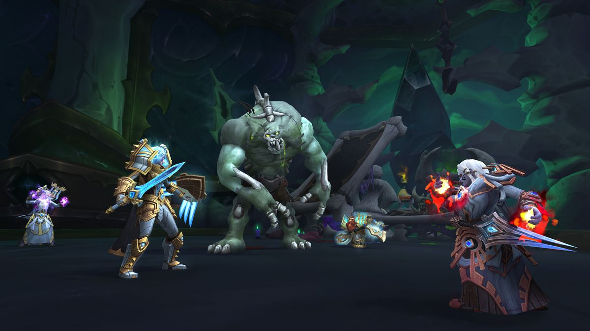 World of Warcraft - a party of Alliance adventurers face a monstrous undead being in a dungeon
