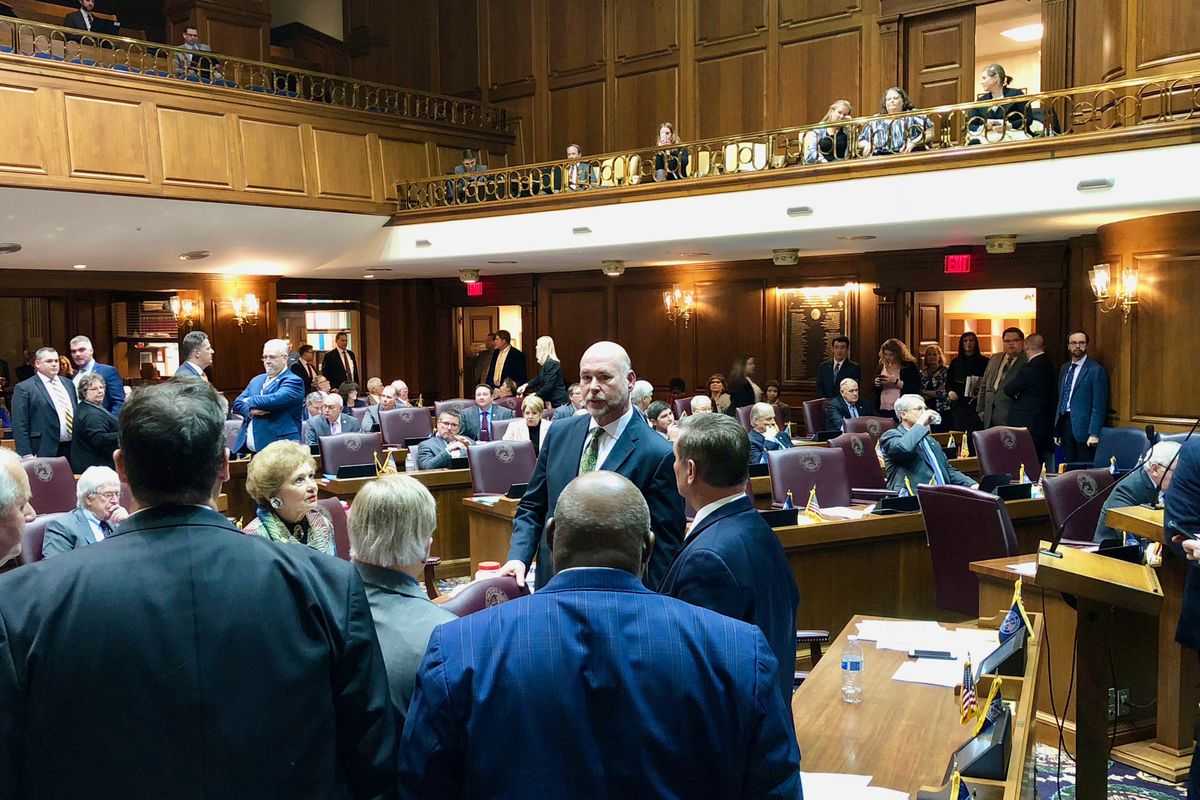 House Speaker Brian Bosma talks with Democrats shortly before the session adjourned without passing several bills.