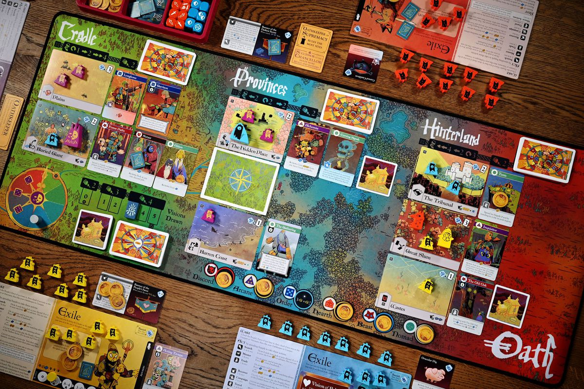 An overview of Oath, set up for play.