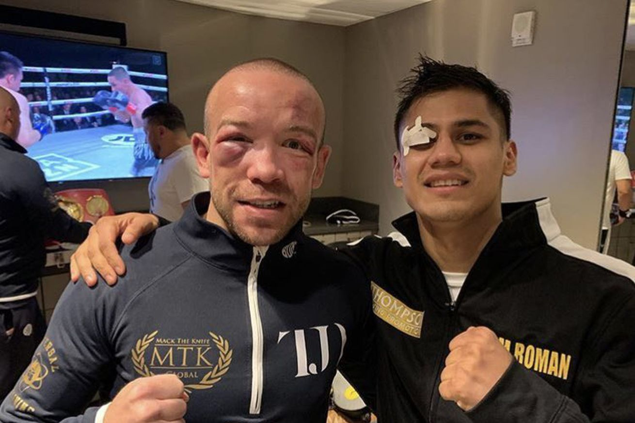 D5ItbVEU8AAasZd.0 - Roman and Doheny show respect after brutal fight