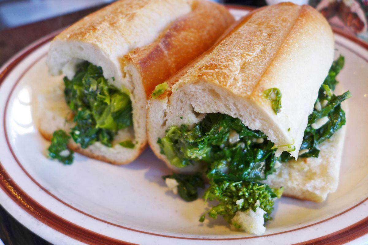 Broccoli rabe hero at Leo's Casa Calamaria, bright green filling in a baguette.