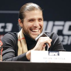 Brian Ortega laughs during press conference.