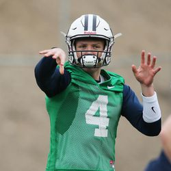 Brigham Young Cougars quarterback Taysom Hill (4) throws during practice in Provo on Tuesday, March 1, 2016.