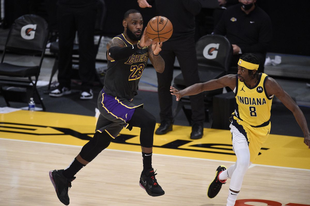 Los Angeles Lakers forward LeBron James (23) passes the ball while Indiana Pacers guard Justin Holiday (8) defends during the second half at Staples Center.