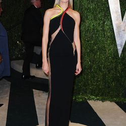 Karolina Kurkova's slicked back hair and cutout gown is a little much.