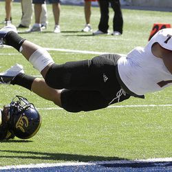Southern Utah's Henna Brown (7) dives into the end zone to score after breaking the tackle of California's Steve Williams during the second half of an NCAA college football game Saturday, Sept. 8, 2012, in Berkeley, Calif. (AP Photo/Ben Margot)