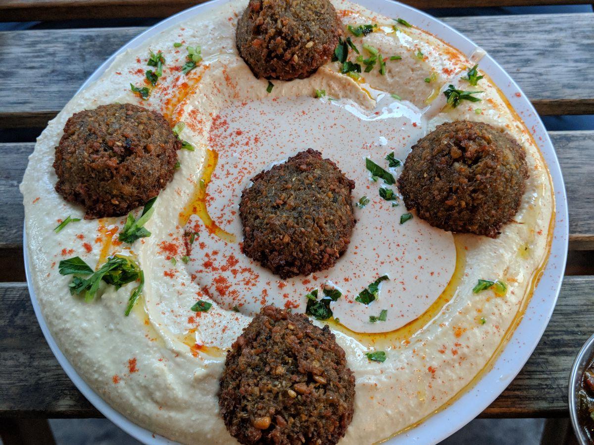 Falafel on hummus at Hummus Bar, an Israeli restaurant in Golders Green, London