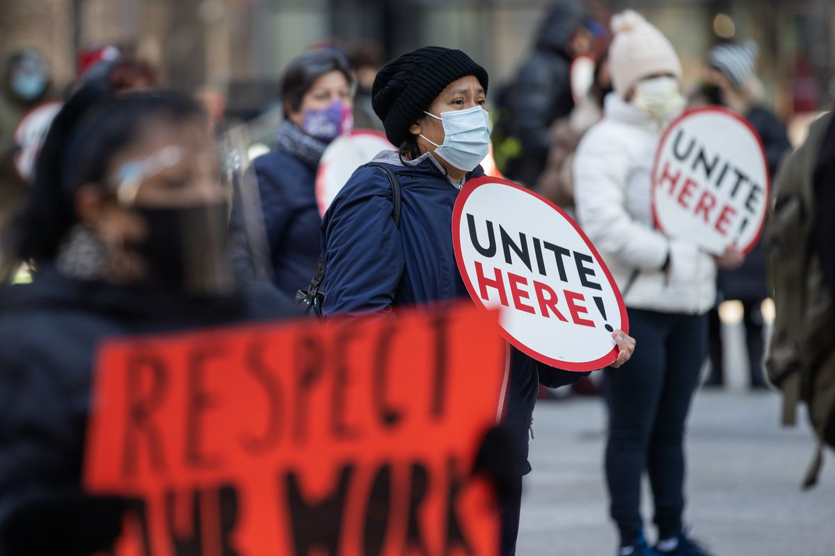 Dozens of out-of-work hotel workers and members of Unite Here Local 1 gathered at Federal Plaza in the Loop in November to demand hotels to give them back their jobs, including their pay raises and benefits, once the economy recovers from the impact of COVID-19.