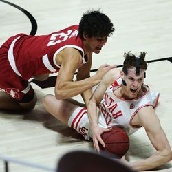 Utah Utes forward Mikael Jantunen (20) and Stanford Cardinal forward Brandon Angel (23) compete for the ball in Salt Lake City on Thursday, Jan. 14, 2021. The Utes won 79-65.