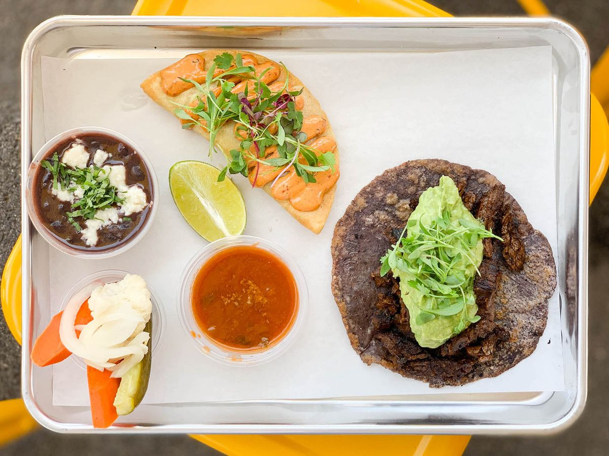 bee taqueria steak fish tacos on plate