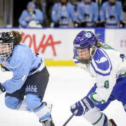 Buffalo Beauts defender Colleen Murphy (left) shadows Connecticut Whale forward Kelly Babstock in a race for the puck during a NWHL game on Dec. 16th, 2107 at HarborCenter in Buffalo, NY.