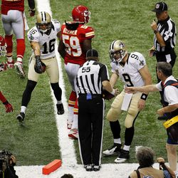New Orleans Saints quarterback Drew Brees (9) challenges the official after wide receiver Lance Moore (16) hit the pylon in the second half of an NFL football game against the Kansas City Chiefs in New Orleans, Sunday, Sept. 23, 2012. After review the pass was ruled incomplete.