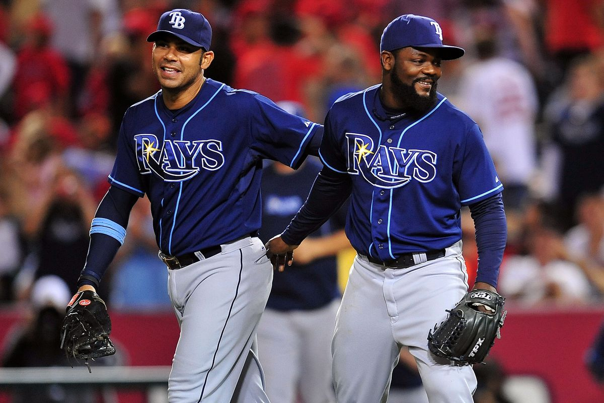 July 28, 2012; Anaheim, CA, USA; Tampa Bay Rays first baseman Carlos Pena (23) and relief pitcher Fernando Rodney (56) celebrate the Rays 3-0 victory against the Los Angeles Angels at Angel Stadium. Mandatory Credit: Gary A. Vasquez-US PRESSWIRE