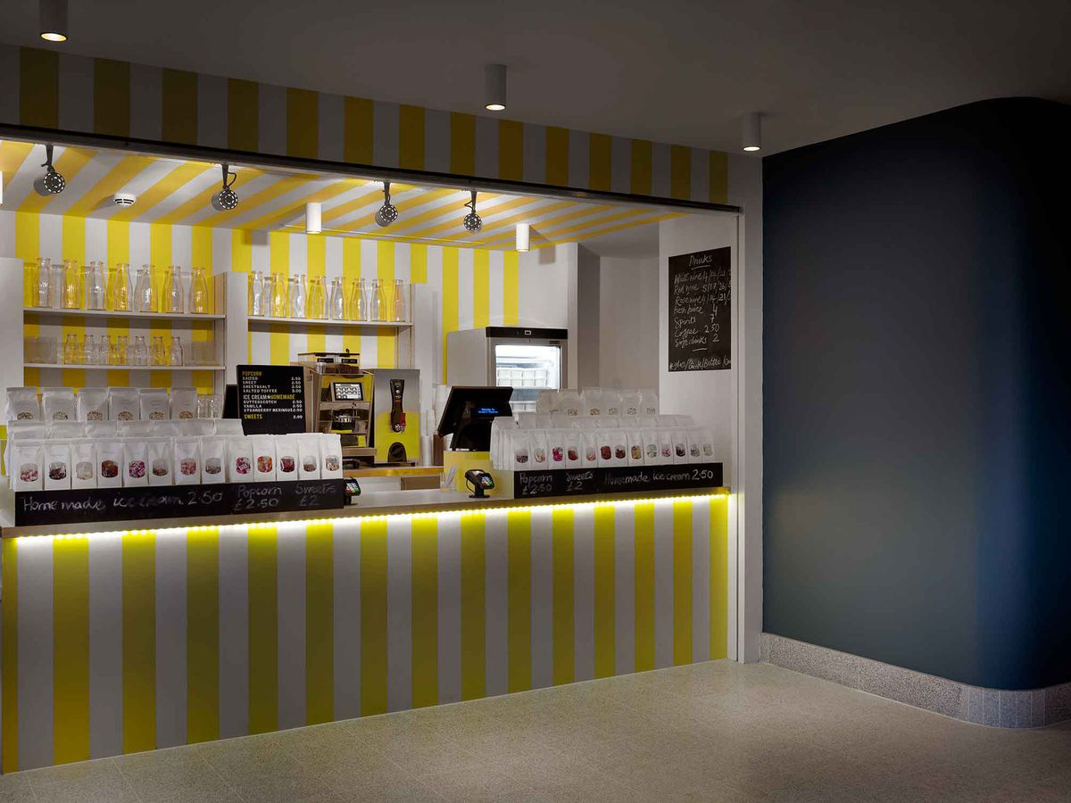 The yellow and white-striped sweet shop at Olympic Studios cinema in Barnes, one of the best places for cinema food in London