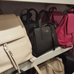 Spitting image of Mansur Gavriel's minimalist backpacks at Kate Spade. We waited only a few minutes in line to get into the store and were greeted with an extra $25 off on top of 40% off everything.