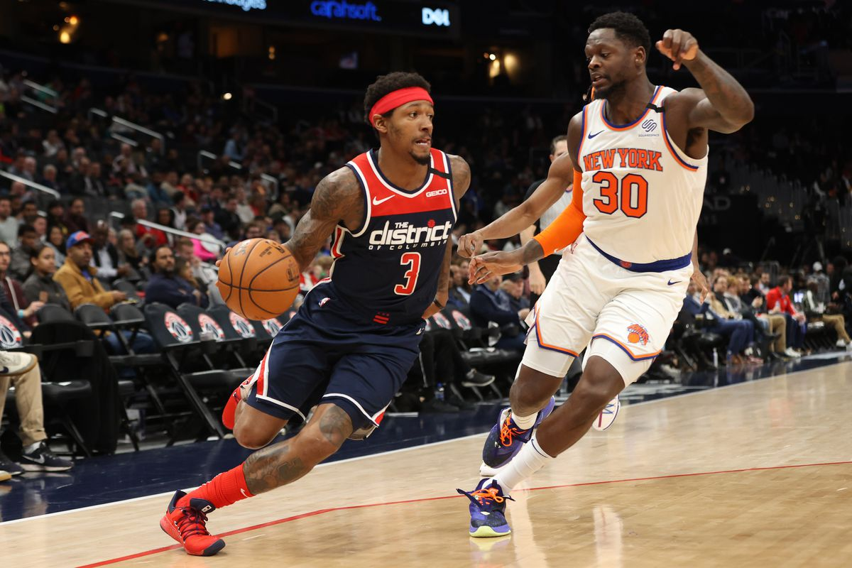 Washington Wizards guard Bradley Beal (3) drives to the basket as New York Knicks forward Julius Randle (30) defends in the third quarter at Capital One Arena.