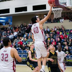 The Eagles Lino Saez (40) flies high from two of his 20 points in the upset win by Layton Christian.