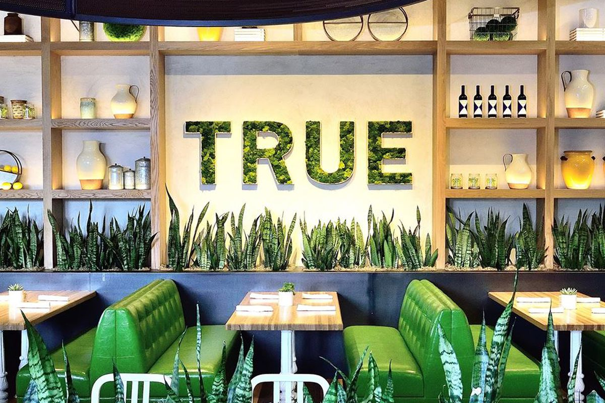 True Food Kitchen with plants in the foreground