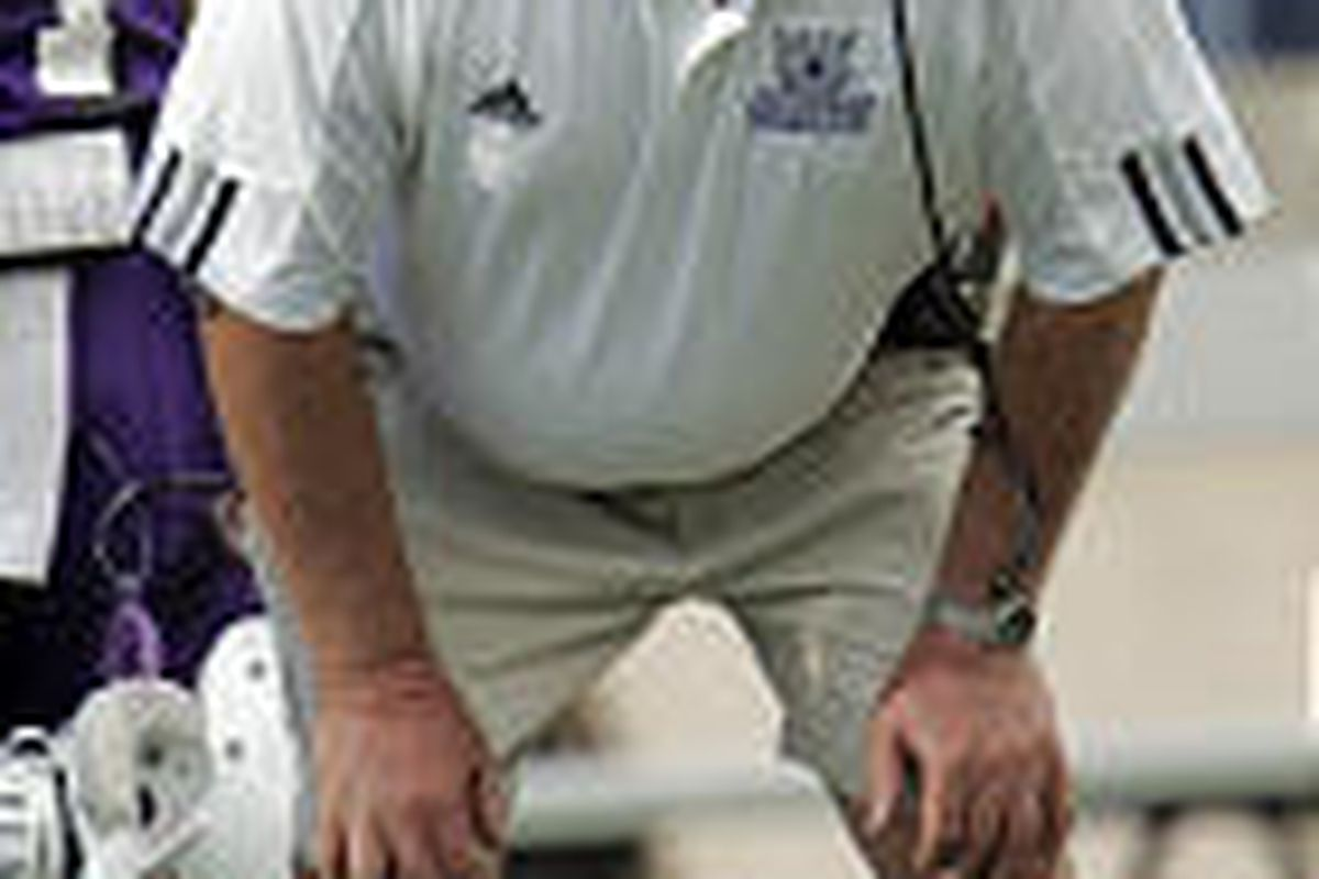 Weber State coach Ron McBride focuses on a play during his debut with the Wildcats.