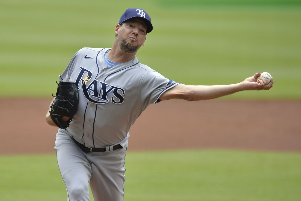Rich Hill #14 of the Tampa Bay Rays pitches during a game against the Atlanta Braves at Truist Park on July 18, 2021 in Atlanta, Georgia.