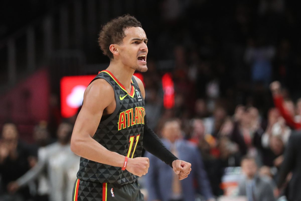 Atlanta Hawks guard Trae Young reacts after a dunk by guard Cam Reddish in the second overtime against the Charlotte Hornets at State Farm Arena.