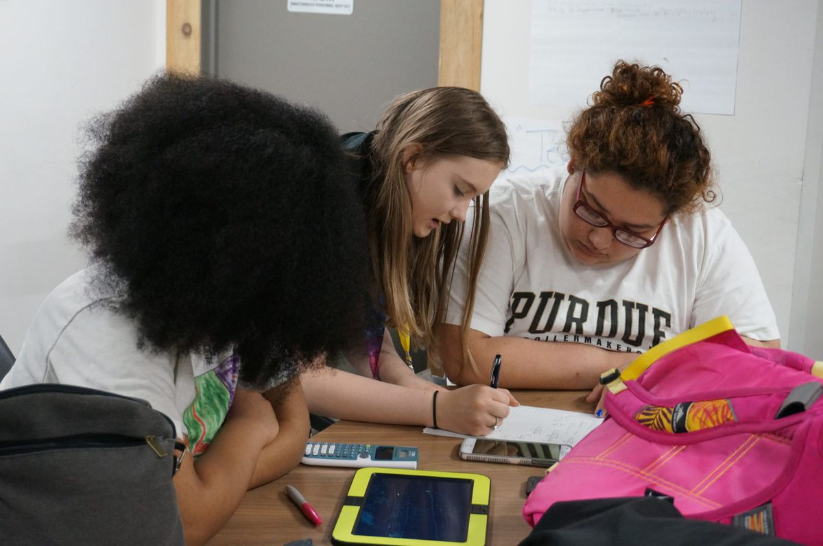 Purdue Polytechnic High School freshman HannaMaria Martinez, right, works on quadratic equations with another student.