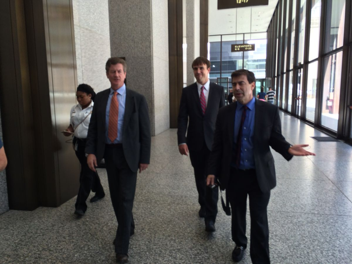 Double Door club owner Sean Mulroney (left) leaves the courthouse with attorneys.   Andy Grimm/Sun-Times