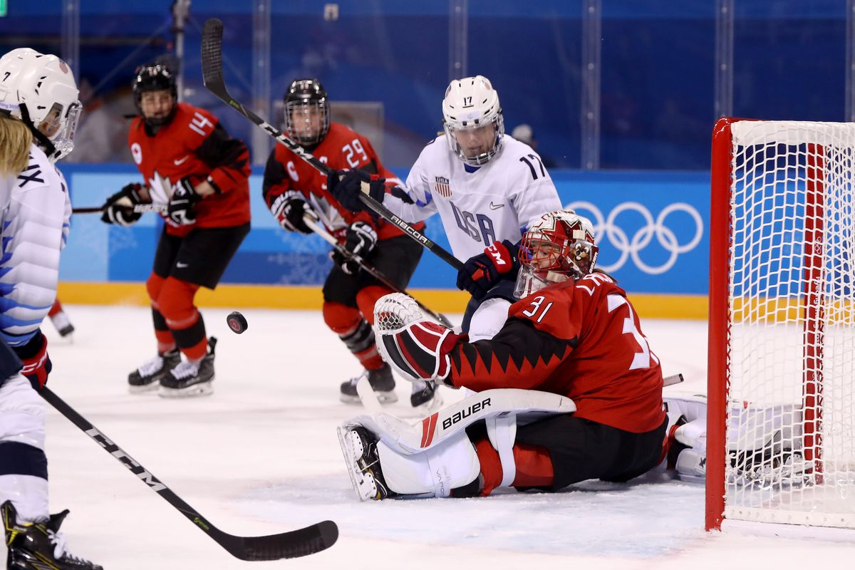 Genevieve Lacasse #31 of Canada tends the goal against Jocelyne Lamoureux #17 of the United States during the Women's Ice Hockey Preliminary Round Group A game on day six of the PyeongChang 2018 Winter Olympic Games