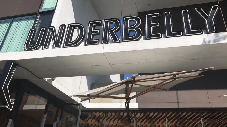 Front signage at Underbelly in Little Italy